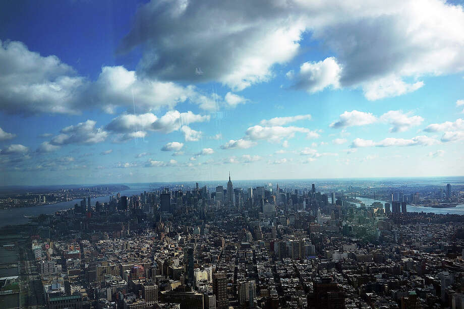 Manhattan is seen from One World Observatory from the 100th floor of One World Trade Center at the Ground Zero site on April 2, 2013 in New York City. One World Observatory, which is situated more than 1,250 feet over lower Manhattan, will open to the public in 2015 and will include a pre-show theater, multiple spaces that allow for panoramas of the New York City region and numerous dining options. When completed, One World Trade Center will be the tallest building in the Western Hemisphere at 1776 feet. Photo: Spencer Platt, Getty Images / 2013 Getty Images