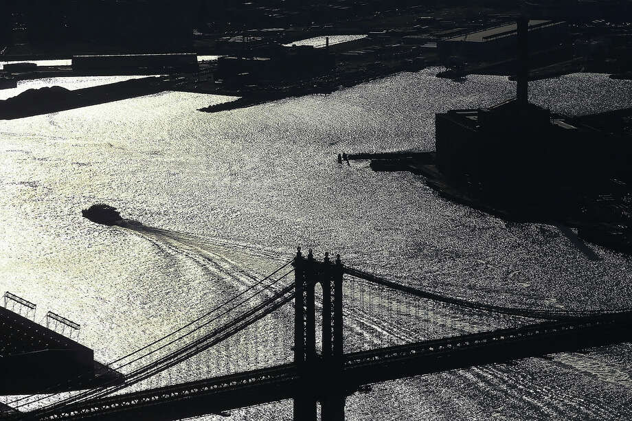 The Manhattan Bridge is seen from the One World Observatory from the 100th floor of One World Trade Center at the Ground Zero site on April 2, 2013 in New York City. One World Observatory, which is situated more than 1,250 feet over lower Manhattan, will open to the public in 2015 and will include a pre-show theater, multiple spaces that allow for panoramas of the New York City region and numerous dining options. When completed, One World Trade Center will be the tallest building in the Western Hemisphere at 1776 feet. Photo: Spencer Platt, Getty Images / 2013 Getty Images