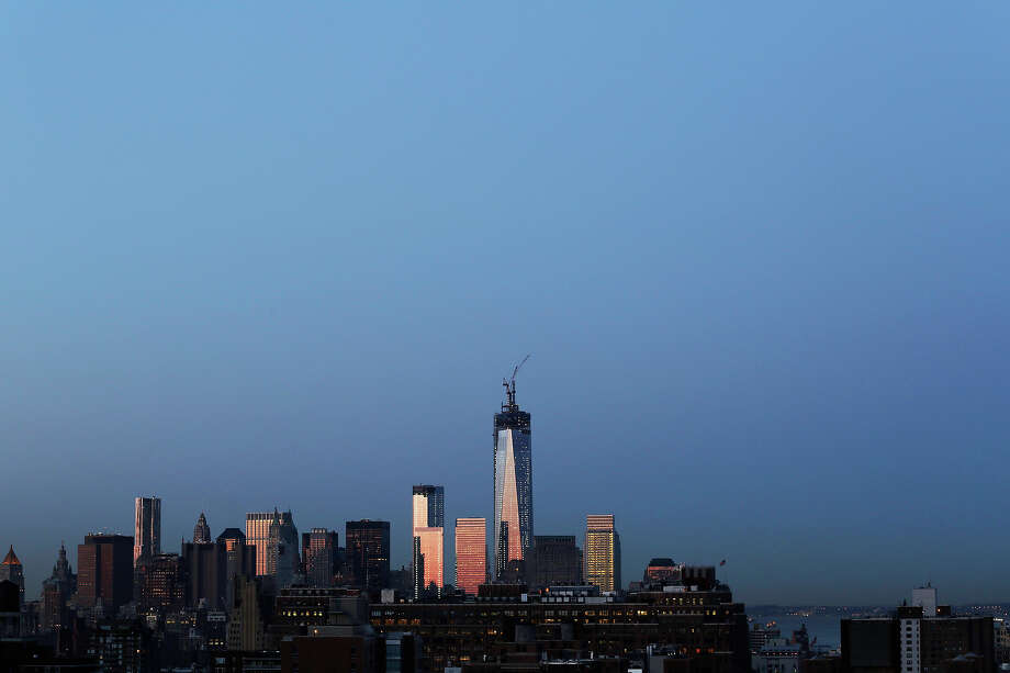 One World Trade Center rises above the lower Manhattan skyline, Wednesday, March 27, 2013 in New York. A pair of construction cranes on top of the tower are installing the spire that will make the 104-floor skyscraper the tallest in the Western Hemisphere. Photo: Mark Lennihan, AP / AP