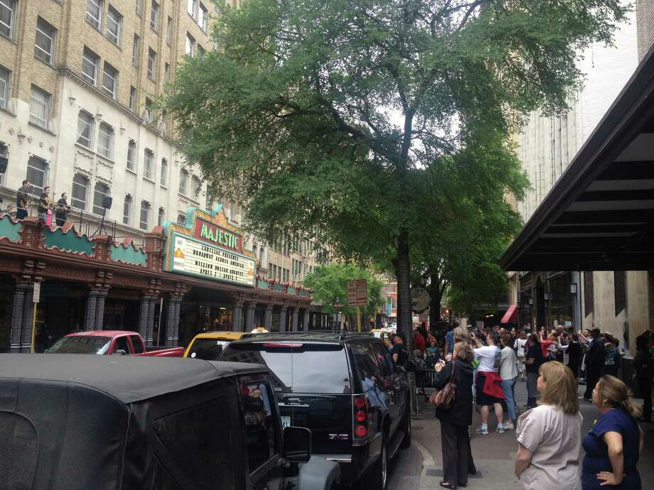 "A crowd gathers across the street from the Majestic Theatre to watch a live rooftop performance from the cast of ""Million Dollar Quartet."" The show opens at the Majestic tonight and runs through April 7. -- Photo: Sarah Tressler"