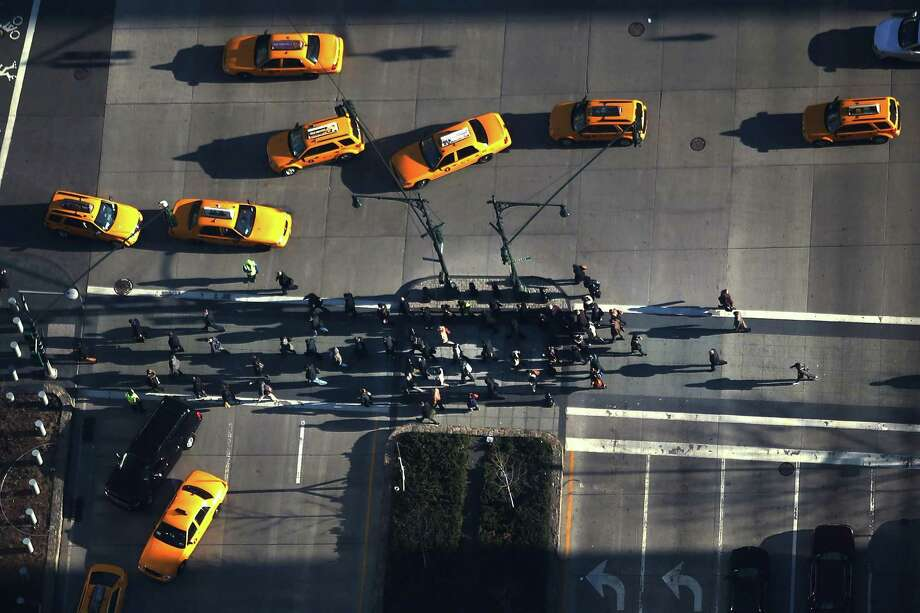 NEW YORK, NY - APRIL 02:  Pedestrians cross the street in lower Manhattan as seen from One World Observatory from the 100th floor of One World Trade Center at the Ground Zero site on April 2, 2013 in New York City. One World Observatory, which is situated more than 1,250 feet over lower Manhattan, will open to the public in 2015 and will include a pre-show theater, multiple spaces that allow for panoramas of the New York City region and numerous dining options. When completed, One World Trade Center will be the tallest building in the Western Hemisphere at 1776 feet. Photo: Spencer Platt, Getty Images / 2013 Getty Images