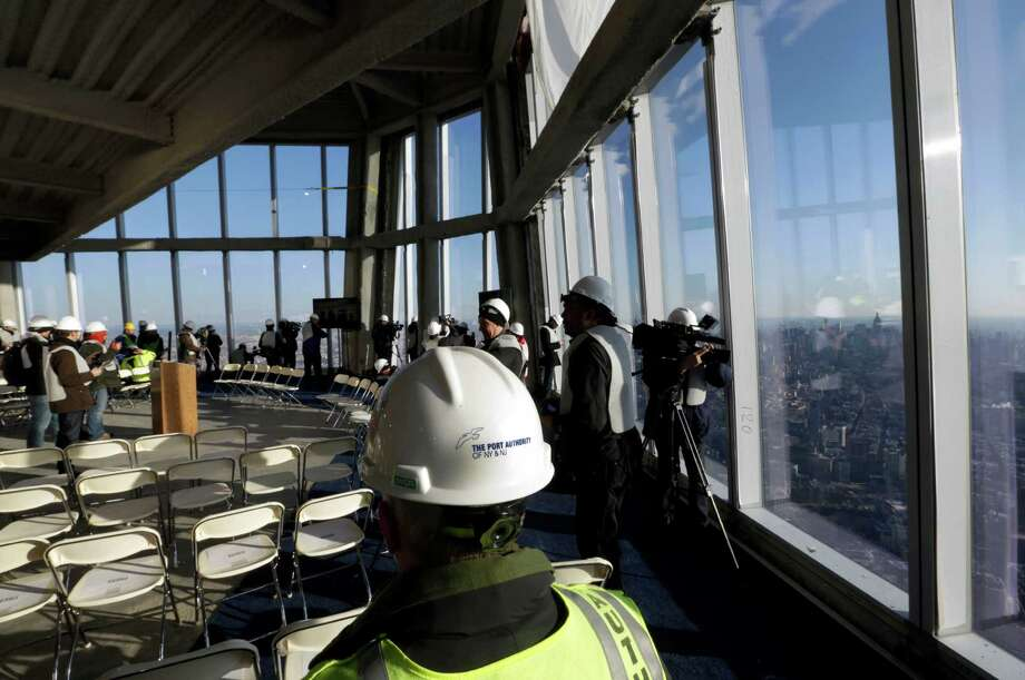 Members of the media tour the unfinished observation deck on the 100th floor of the One World Trade Center building, under construction in New York, Tuesday, April 2, 2013. The observation deck will occupy the tower's 100th through 102nd floors. Elevators will whisk visitors to the top in just one minute but the experience of visiting the attraction will take an hour. Photo: Richard Drew, AP / AP