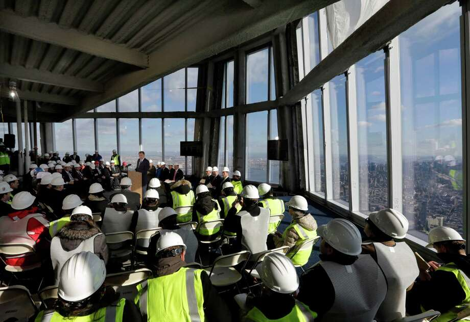 Port Authority Chairman David Samson, at podium center left, addresses a news conference in observation deck on the 100th floor of the One World Trade Center building, under construction in New York, Tuesday, April 2, 2013. The observation deck will occupy the tower's 100th through 102nd floors. Elevators will whisk visitors to the top in just one minute but the experience of visiting the attraction will take an hour. Photo: Richard Drew, AP / AP