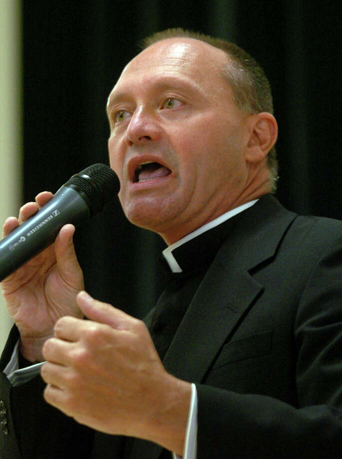 FILE - In this May 4, 2006 file photo, Monsignor Kevin Wallin speaks at the Catholic Center, headquarters of the Diocese of Bridgeport, in Bridgeport, Conn.  Wallin, of Waterbury, Conn., pleaded guilty Tuesday, April 2, 2013, in federal court in Hartford, to conspiracy to possess with intent to distribute methamphetamine. He had been accused of making more than $300,000 in methamphetamine sales out of his apartment, and running an adult video and sex toy shop.  Wallin, who resigned as pastor of St. Augustine Parish in Bridgeport in 2011, is scheduled to be sentenced June 25.   MAGS OUT; MANDATORY CREDIT Photo: Connecticut Post