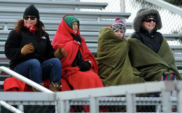 From left, Niskayuna fans Emily Miller, Pat Miller, Isabella Sandroni and Valerie Sandroni try to stay warm in the freezing wind during a lacrosse game against Shenendehowa on Tuesday, April 2, 2013 in Clifton Park, N.Y. (Lori Van Buren / Times Union) Photo: Lori Van Buren