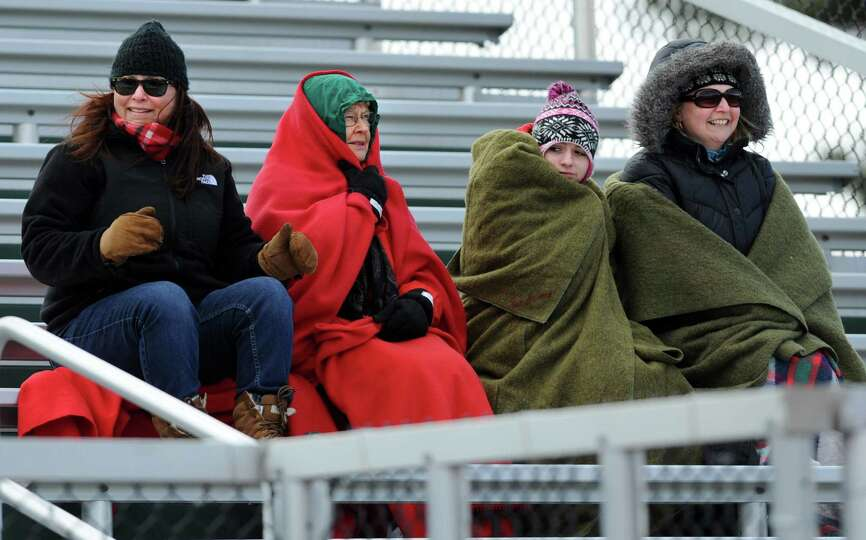 From left, Niskayuna fans Emily Miller, Pat Miller, Isabella Sandroni and Valerie Sandroni try to st