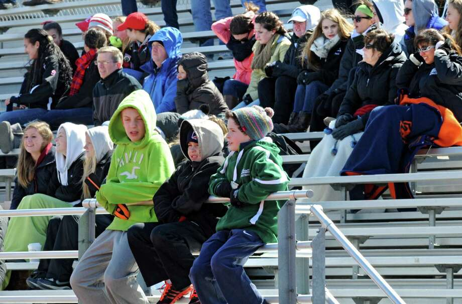 Fans try to stay warm in the freezing wind during a lacrosse game between Niskayuna and Shenendehowa on Tuesday, April 2, 2013 in Clifton Park, N.Y. (Lori Van Buren / Times Union) Photo: Lori Van Buren