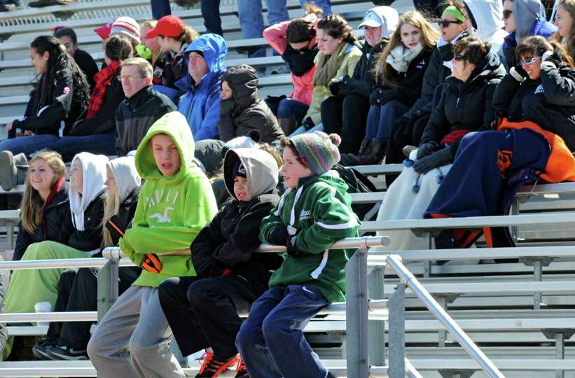 Fans try to stay warm in the freezing wind during a lacrosse game between Niskayuna and Shenendehowa
