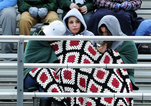 From left, Shenendehowa students Meaghan Potter, 17, Taylor Hennigan, 17, and Kelsey Hulihan, 17, try to stay warm in the freezing wind during a lacrosse game against Niskayuna  on Tuesday, April 2, 2013 in Clifton Park, N.Y. (Lori Van Buren / Times Union) Photo: Lori Van Buren