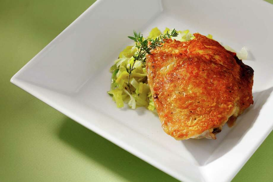Pan-Fried Chicken Thighs With Buttered Leeks. Photo: Craig Lee / ONLINE_YES