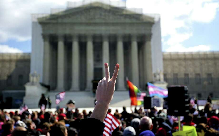 Demonstrators for and against same-sex marriage have been gathering outside the U.S. Supreme Court in Washington. For one reader, the issue is not the unions but what to call the unions. Photo: Doug Mills / New York Times