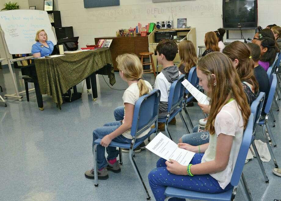 Joyce Sullivan, Randolph Middle School choir director, rehearses songs with her sixth-grade choir class March 21 at Joint Base San Antonio-Randolph. Photo: U.S. Air Force