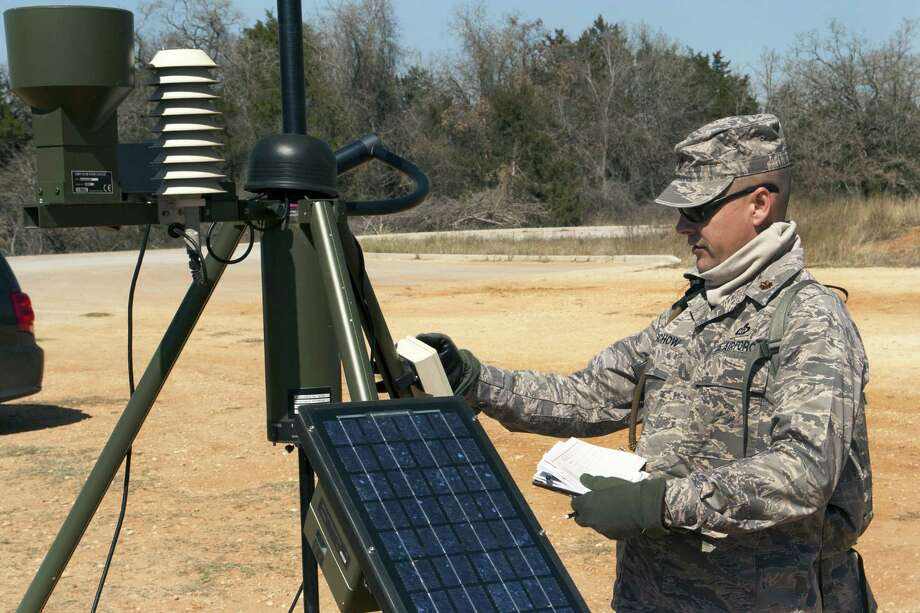 Maj. Paul E. Buschow, commander of the Texas Air National Guard's 209th Weather Flight, based at Camp Mabry in Austin, participates in weather training near Bastrop on March 2. Photo: Texas National Guard