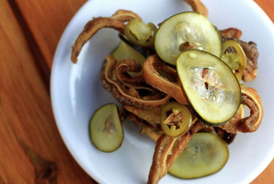 Batanga serves Crispy Pig Ears, featuring pickled jalapeños and cucumber. Photo: Karen Warren, Staff / © 2013 Houston Chronicle