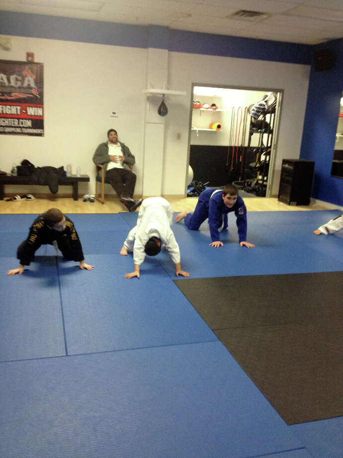 A Monday Night Tiny Titans youth jiu jitsu class