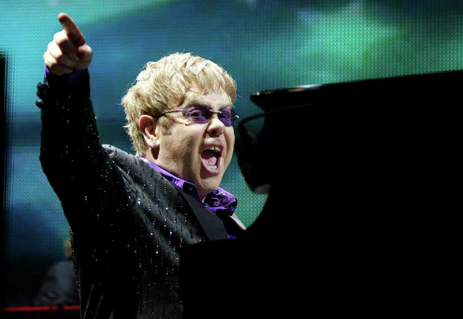 FILE - This June 30, 2012 file photo shows British pop star Elton John performing during the Euro 2012 soccer championship in Kiev, Ukraine. The Songwriters Hall of Fame announced Tuesday, April 2, 2013, that Elton John and Bernie Taupin will be the 2013 recipients of the esteemed Johnny Mercer Award. The 44th Annual Induction and Awards Dinner is slated for Thursday, June 13 in New York.  (AP Photo/Efrem Lukatsky, file) Photo: Efrem Lukatsky