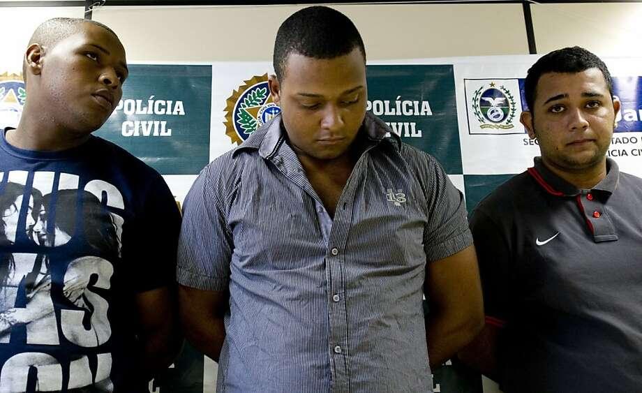 Wallace Aparecido Silva (left), Carlos Armando Costa dos Santos and Jonathan Froudakis de Souza are accused in the brutal attack in Rio de Janeiro. Photo: Vanderlei Almeida, AFP/Getty Images