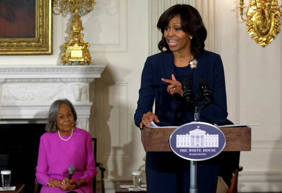 "First Lady Michelle Obama introduces a panel of the cast and crew of the movie ""42"", next to Rachel Robinson, widow of baseball great Jackie Robinson, before a workshop for high school and college students, Tuesday, April 2, 2013, in the State Dining Room of the White House in Washington.  (AP Photo/Jacquelyn Martin) Photo: Jacquelyn Martin"