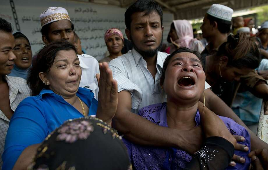 The mother of a fire victim weeps at her son's burial near Rangoon, Burma. The mosque blaze appears to be an accident, but Muslims, who have been feuding with Buddhists, suspect arson. Photo: Gemunu Amarasinghe, Associated Press