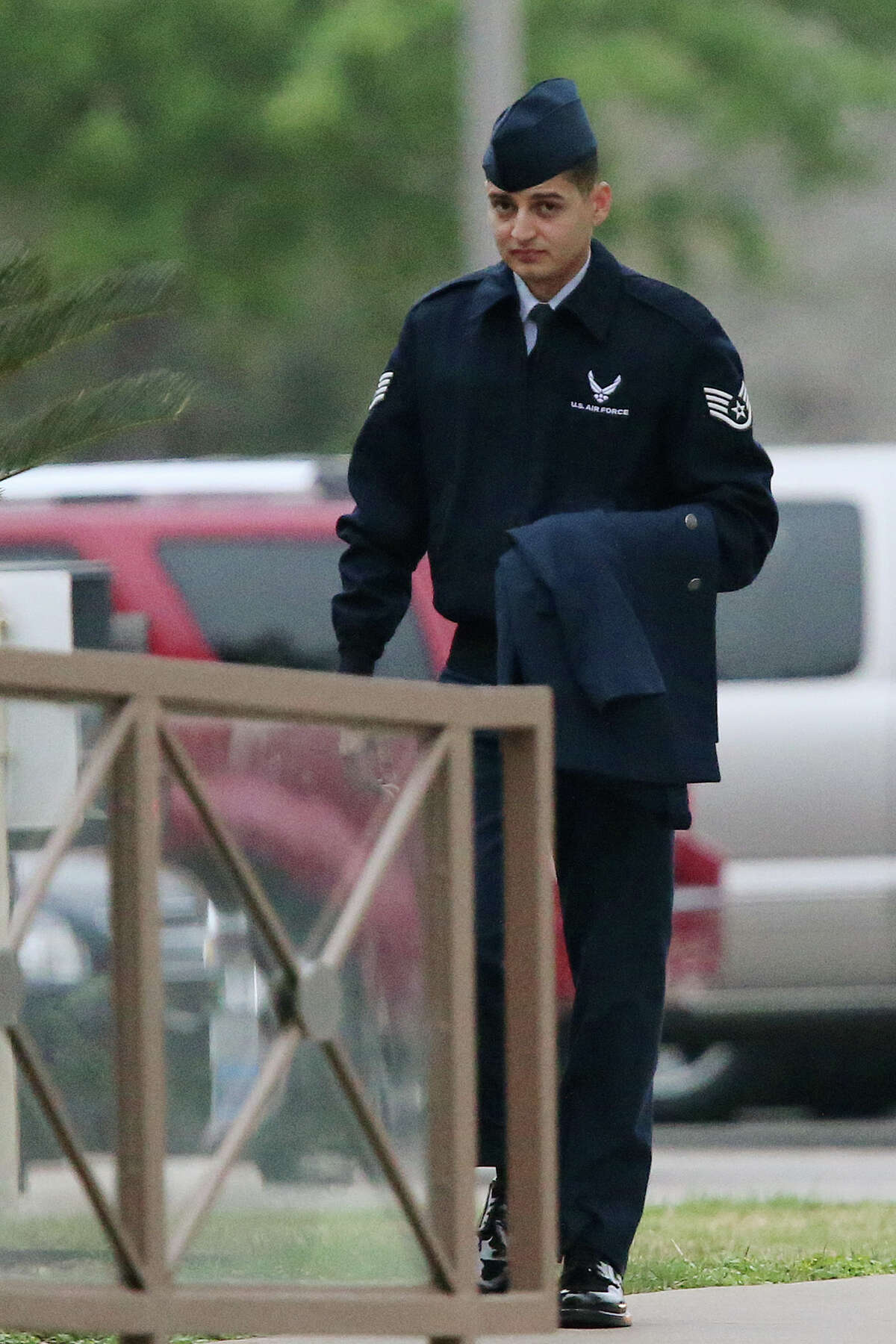 U.S. Air Force Staff Sgt. William Romero arrives for his court-martial at Lackland Air Force Base, Tuesday, April 2, 2013.
