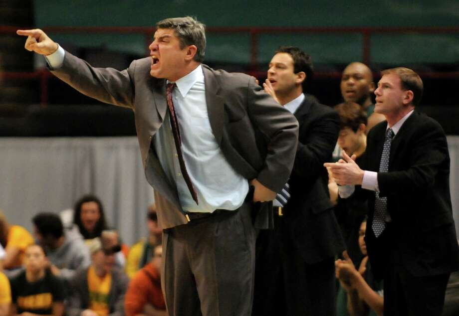 Times Union staff photo by Cindy Schultz -- Loyola's head coach Jimmy Patsos, left, reacts to a call during their basketball game against Siena on Saturday, Feb. 16, 2008, at the Times Union Center in Albany, N.Y. (WITH IORIZZO STORY) Photo: CINDY SCHULTZ, DG / ALBANY TIMES UNION