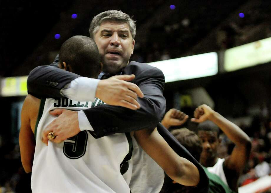 Times Union staff photo by Cindy Schultz -- Loyola coach Jimmy Patsos hugs player Marquis Sullivan (5) when they beat Fairfield 64-59 during their basketball game during the MAAC Tournament on Saturday, March 8, 2008, at the Times Union Center in Albany, N.Y. (WITH STORY) Photo: CINDY SCHULTZ, DG / ALBANY TIMES UNION
