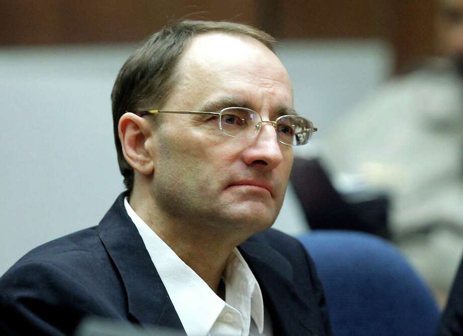 Christian Karl Gerhartsreiter, sits and listens during opening statements in his trial in Los Angeles Criminal Court March 18, 2013. A prosecutor told jurors Monday he will prove a cold-case murder allegation against the German immigrant who spent years moving through U.S. society under a series of aliases, most notoriously posing as a member of the fabled Rockefeller family. He has pleaded not guilty to the killing of John Sohus, 27, who disappeared with his wife, Linda, in 1985 while Gerhartsreiter, using an alias was a guest cottage tenant at the home of Sohus' mother, where the couple lived. (AP Photo/Nick Ut ) Photo: Nick Ut, Associated Press / AP