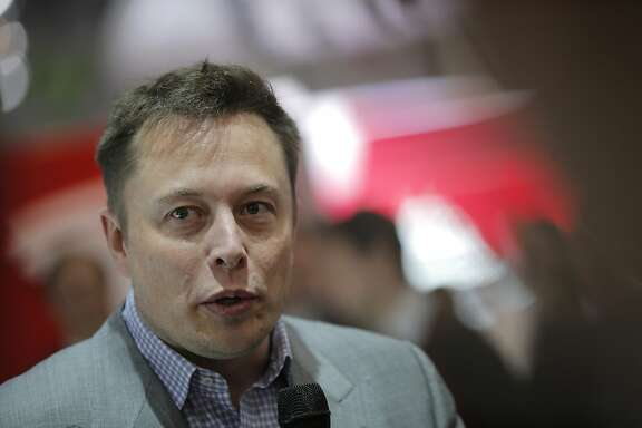 Elon Musk, billionaire and chief executive officer of Tesla Motors Inc., speaks to the media on the first day of the 83rd Geneva International Motor Show in Geneva, Switzerland, on Tuesday, March 5, 2013. This year's show opens to the public on Mar. 7, and is set to feature more than 100 product premiers from the world's automobile manufacturers. Photographer: Valentin Flauraud/Bloomberg