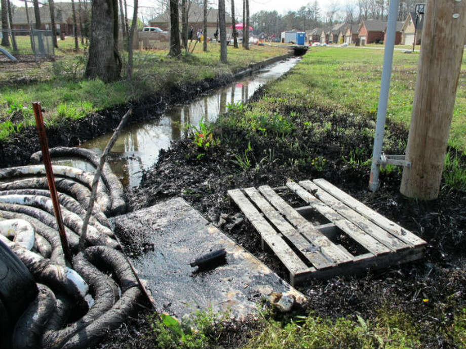 This photo taken Sunday, March 31, 2013 shows the Northwoods Subdivision in Mayflower, Ark., the site of where a petroleum line ruptured near a drainage ditch, leaking oil into a stream leading into Lake Conway. Residents affected by an oil spill in central Arkansas could be displaced for weeks, officials said, as crews continued to clean up the thousands of barrels of oil and water that leaked from a pipeline.