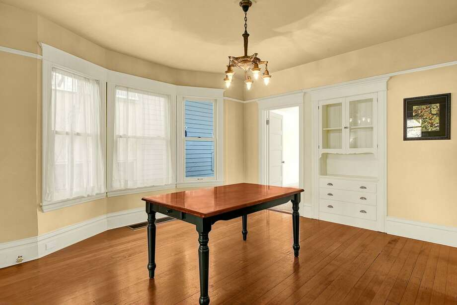 Dining room of 2415 E. Spring St. The 2,180-square-foot Craftsman, built in 1907, has three bedrooms, 1.5 bathrooms, high ceilings, built-ins, a back porch and a patio on a 3,000-square-foot lot. It's listed for $489,900. Photo: Josh Phoenix/HD Estates,  Courtesy Marcus Holmes/WaLaw Realty