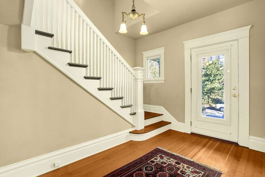 Entry of 2415 E. Spring St. The 2,180-square-foot Craftsman, built in 1907, has three bedrooms, 1.5 bathrooms, high ceilings, built-ins, a back porch and a patio on a 3,000-square-foot lot. It's listed for $489,900. Photo: Josh Phoenix/HD Estates, Courtesy Marcus Holmes/WaLaw Realty