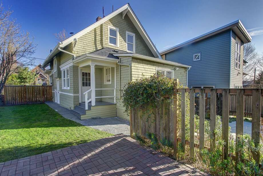 Back yard of 2415 E. Spring St. The 2,180-square-foot Craftsman, built in 1907, has three bedrooms, 1.5 bathrooms, high ceilings, built-ins, a back porch and a patio on a 3,000-square-foot lot. It's listed for $489,900. Photo: Josh Phoenix/HD Estates,  Courtesy Marcus Holmes/WaLaw Realty