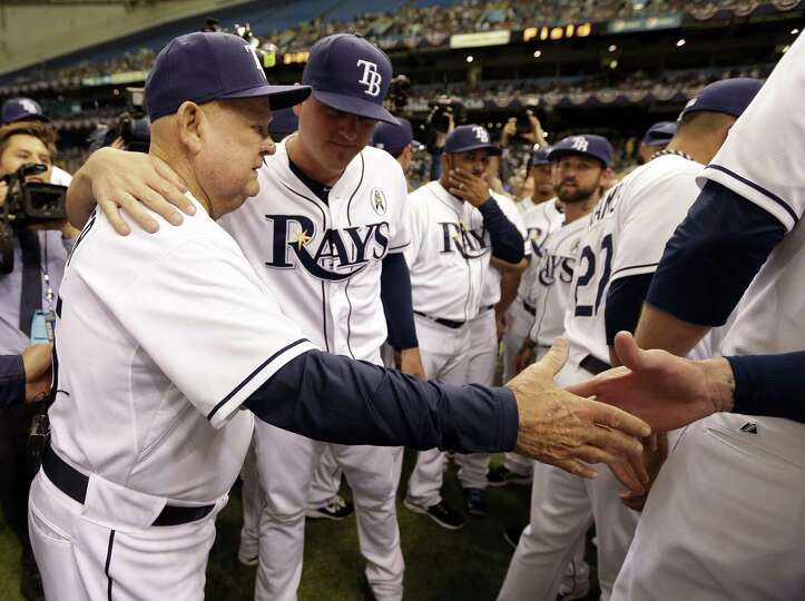 Tampa Bay Rays senior advisor Don Zimmer,  left, is honored by teammates after his son Tom threw out