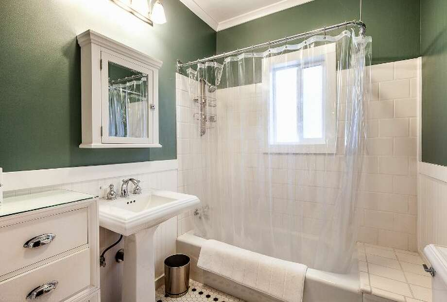 Bathroom of 711 27th Ave. The 1,900-square-foot Craftsman, built in 1908, has three bedrooms, one bathroom, a partially finished basement, a front porch and a back deck on a 3,600-square-foot lot. It's listed for $445,000. Photo: Courtesy Shane Ristine And Steve Foss/Windermere Real Estate