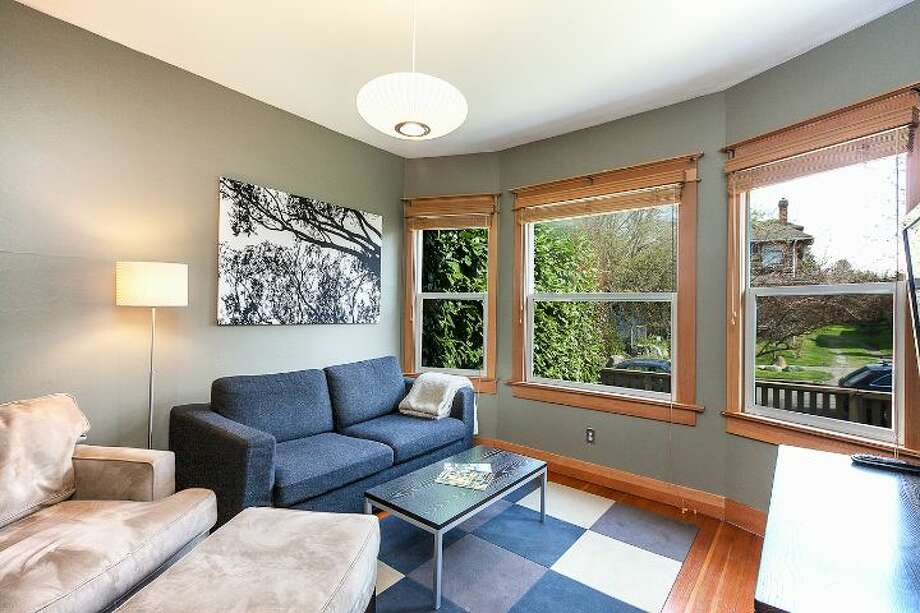 Living room of 711 27th Ave. The 1,900-square-foot Craftsman, built in 1908, has three bedrooms, one bathroom, a partially finished basement, a front porch and a back deck on a 3,600-square-foot lot. It's listed for $445,000. Photo: Courtesy Shane Ristine And Steve Foss/Windermere Real Estate