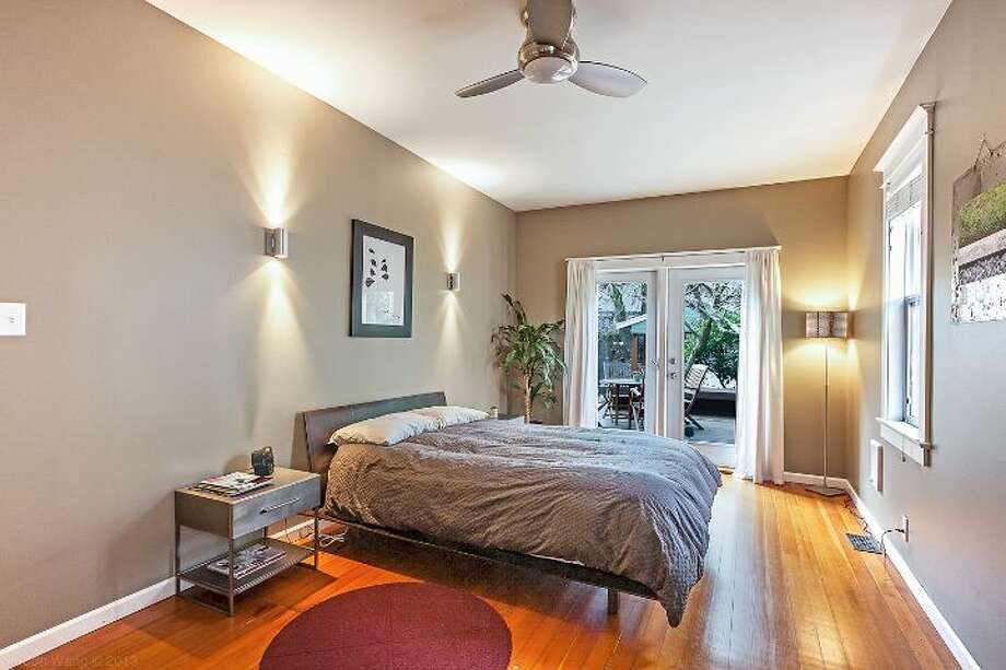 Bedroom of 711 27th Ave. The 1,900-square-foot Craftsman, built in 1908, has three bedrooms, one bathroom, a partially finished basement, a front porch and a back deck on a 3,600-square-foot lot. It's listed for $445,000. Photo: Courtesy Shane Ristine And Steve Foss/Windermere Real Estate