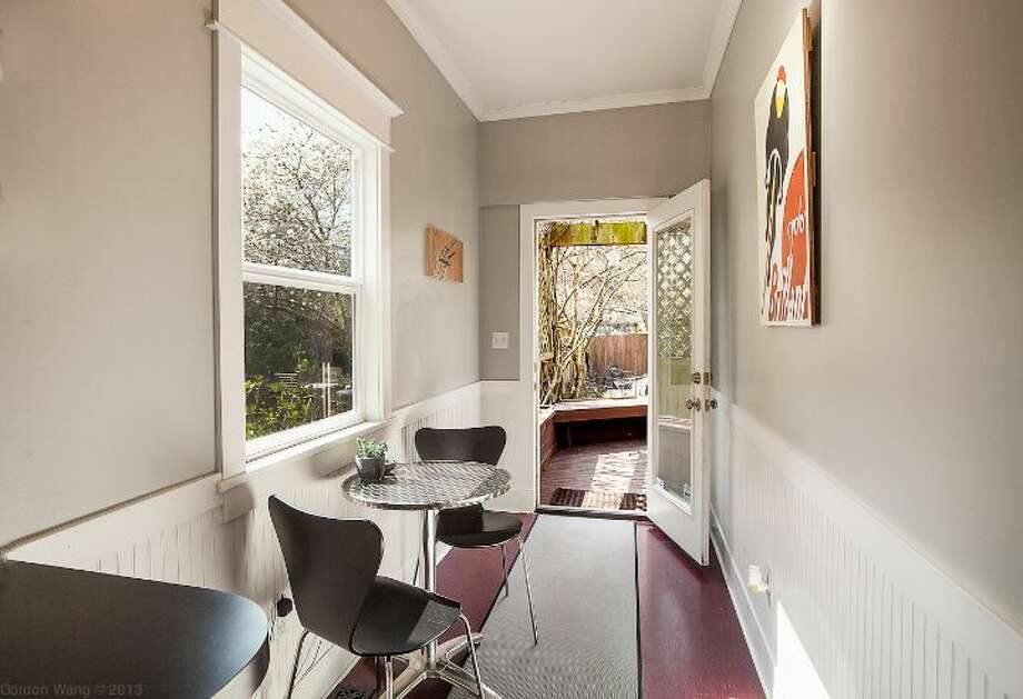 Breakfast nook of 711 27th Ave. The 1,900-square-foot Craftsman, built in 1908, has three bedrooms, one bathroom, a partially finished basement, a front porch and a back deck on a 3,600-square-foot lot. It's listed for $445,000. Photo: Courtesy Shane Ristine And Steve Foss/Windermere Real Estate