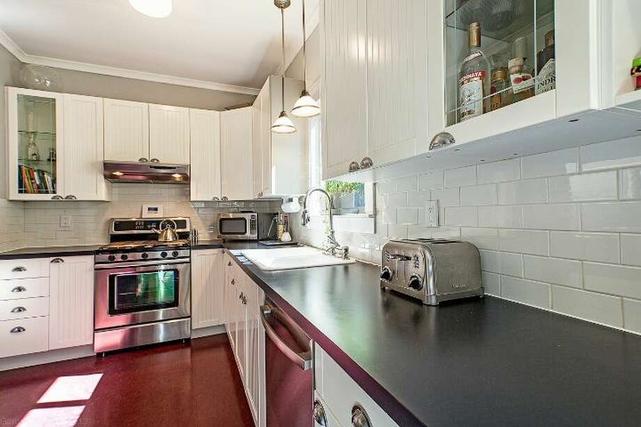 Kitchen of 711 27th Ave. The 1,900-square-foot Craftsman, built in 1908, has three bedrooms, one bathroom, a partially finished basement, a front porch and a back deck on a 3,600-square-foot lot. It's listed for $445,000. Photo: Courtesy Shane Ristine And Steve Foss/Windermere Real Estate
