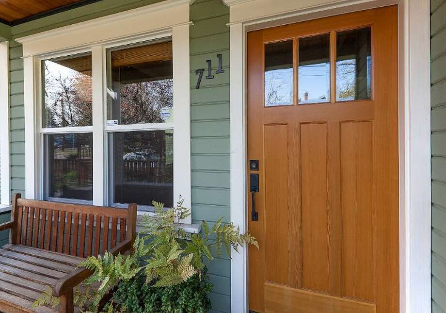 Front of 711 27th Ave. The 1,900-square-foot Craftsman, built in 1908, has three bedrooms, one bathroom, a partially finished basement, a front porch and a back deck on a 3,600-square-foot lot. It's listed for $445,000. Photo: Courtesy Shane Ristine And Steve Foss/Windermere Real Estate