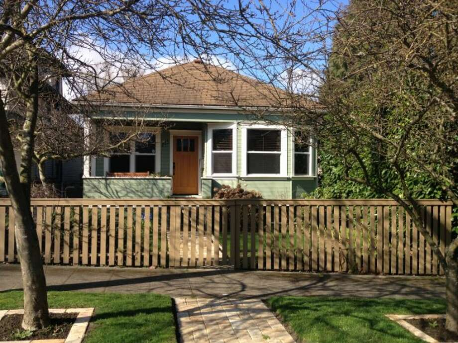 Looking to spend a little less? Check out 711 27th Ave. The 1,900-square-foot Craftsman, built in 1908, has three bedrooms, one bathroom, a partially finished basement, a front porch and a back deck on a 3,600-square-foot lot. It's listed for $445,000. Photo: Courtesy Shane Ristine And Steve Foss/Windermere Real Estate