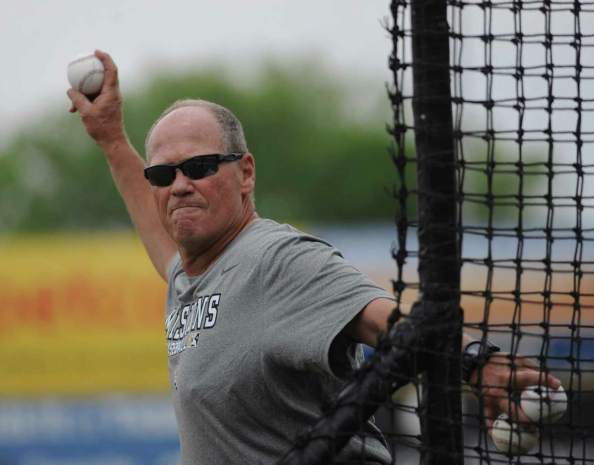 San Antonio Missions manager Rich Dauer pitches batting practice during a team workout at Nelson Wolff Stadium on Tuesday, April 2, 2013. The Missions open their Texas League schedule at home against Tulsa at 7:05 p.m. on April 4.