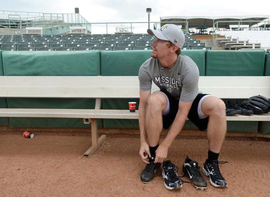 Pitcher Chris Rearick tis his laces during a San Antonio Missions team workout at Nelson Wolff Stadium on Tuesday, April 2, 2013. The Missions open their Texas League schedule at home against Tulsa at 7:05 p.m. on April 4. Photo: Billy Calzada, San Antonio Express-News / San Antonio Express-News