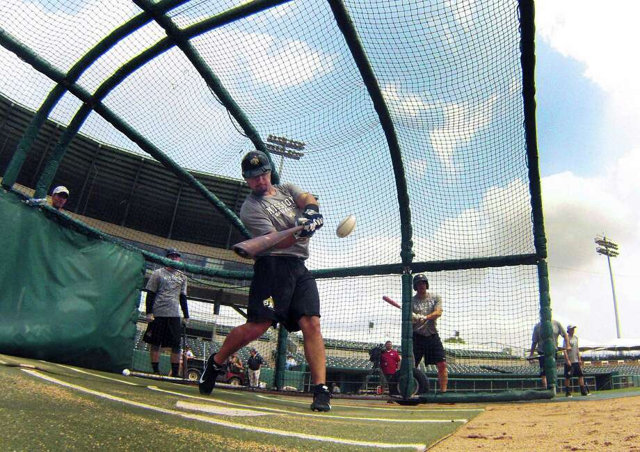 San Antonio Missions catcher Eddy Rodriguez hits during a team workout at Nelson Wolff Stadium on Tuesday, April 2, 2013. The Missions open their Texas League schedule at home against Tulsa at 7:05 p.m. on April 4. Photo: Billy Calzada, San Antonio Express-News / San Antonio Express-News