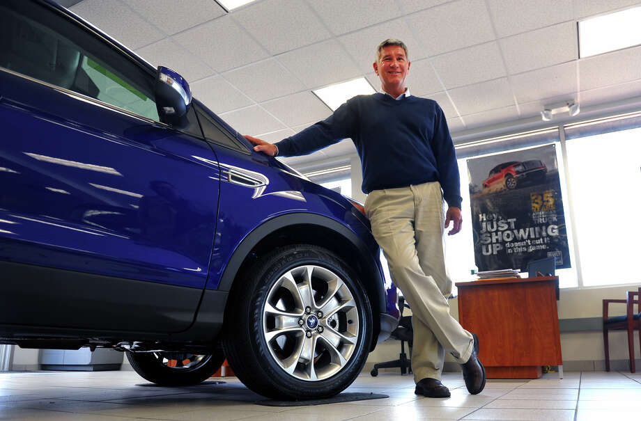 Park City Ford President David Flint poses in the showroom at the dealership in Bridgeport, Conn. on Tuesday April 2, 2013. New car sales have risen to a six-year high last month and Flint says sales from his lot has gone up 22 percent from a year ago. Photo: Christian Abraham / Connecticut Post