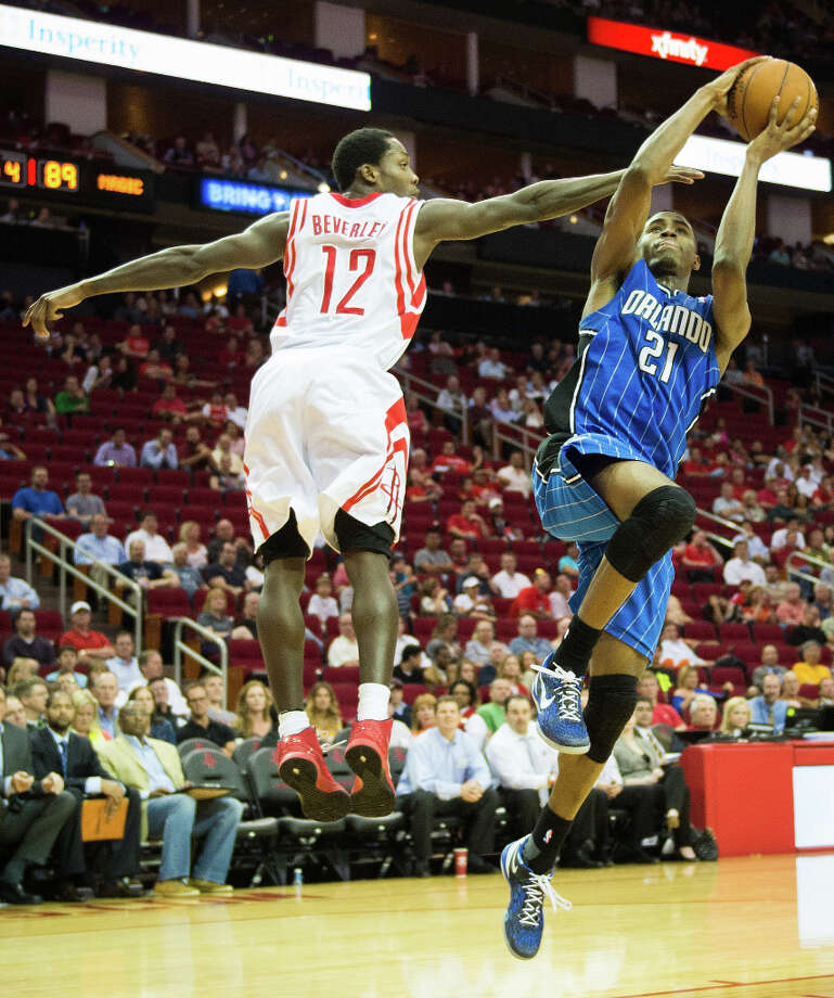 Magic small forward Maurice Harkless shoots past Rockets point guard Patrick Beverley.  Harkless scored a career-high 28 points. Photo: Smiley N. Pool, Houston Chronicle / © 2013  Houston Chronicle