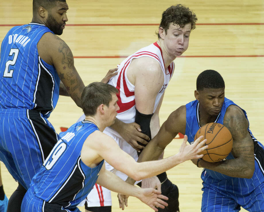 Magic forward DeQuan Jones comes up with a loose ball from Rockets center Omer Asik. Photo: Smiley N. Pool, Houston Chronicle / © 2013  Houston Chronicle