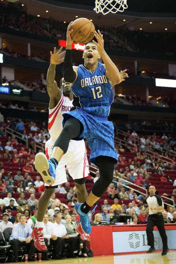 Magic small forward Tobias Harris (12) drives to the basket past Rockets point guard Patrick Beverley. Photo: Smiley N. Pool, Houston Chronicle / © 2013  Houston Chronicle