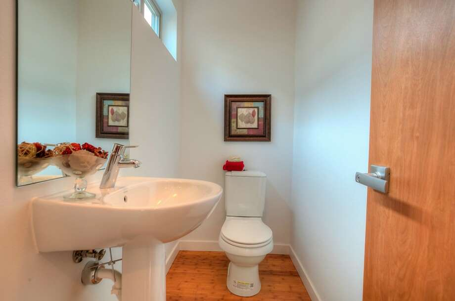 Powder room of 319 21st Ave. The 1,560-square-foot house, built this year, has three bedrooms, 2.25 bathrooms, a front stoop and a patio. It's listed for $469,950. Photo: Layne Freedle Photography,  Courtesy Vu Nguyen/John L. Scott Real Estate