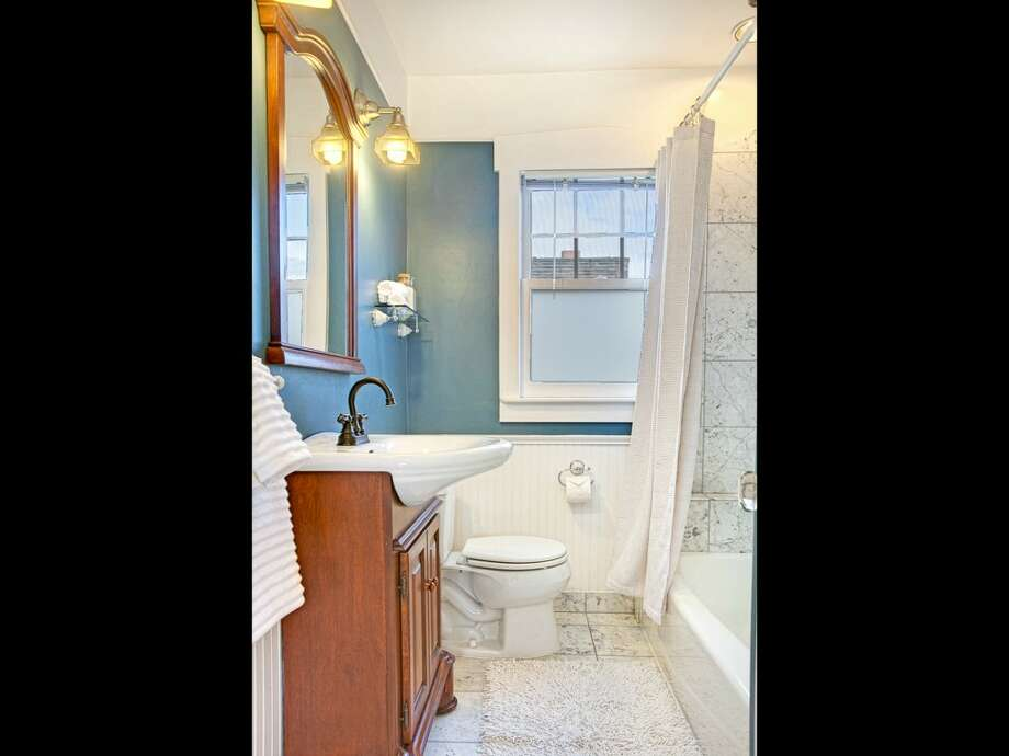 Bathroom of 207 25th Ave. The 2,210-square-foot house, built in 1926, has three bedrooms, two bathrooms, a family room, French doors, vaulted ceilings, skylights, a deck and a patio on a 3,040-square-foot lot. It's listed for $489,000, although a sale is pending. Photo: Courtesy Deirdre Doyle And Brad Hinckley/Windermere Real Estate