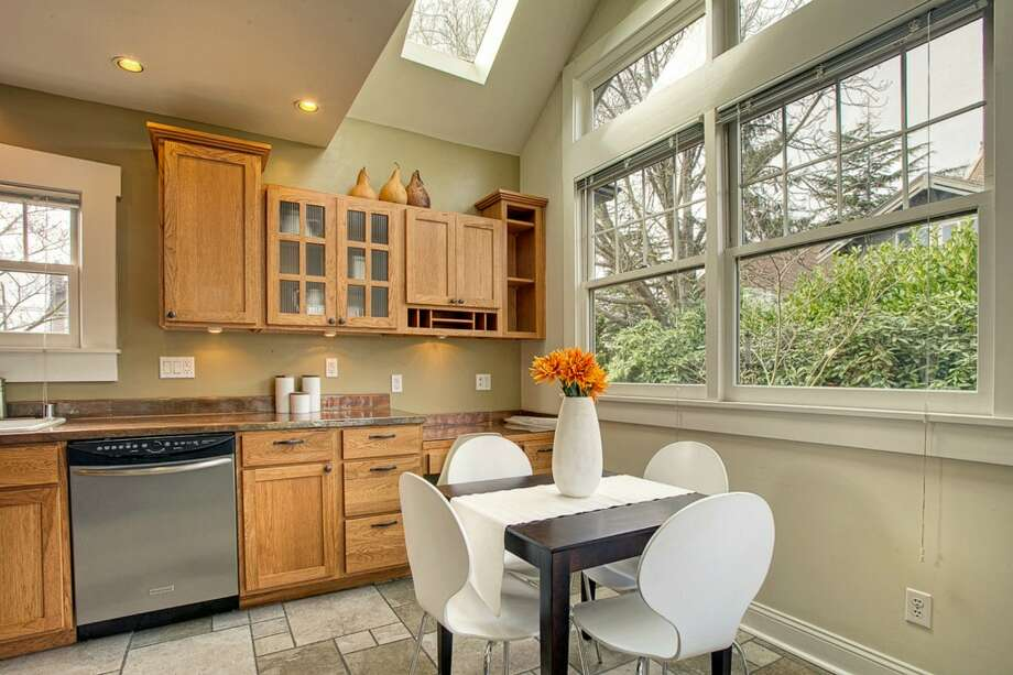 Kitchen of 207 25th Ave. The 2,210-square-foot house, built in 1926, has three bedrooms, two bathrooms, a family room, French doors, vaulted ceilings, skylights, a deck and a patio on a 3,040-square-foot lot. It's listed for $489,000, although a sale is pending. Photo: Courtesy Deirdre Doyle And Brad Hinckley/Windermere Real Estate